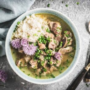 Pressure Cooker Chicken Gizzards and Broth served with Rice and Chive Blossoms y