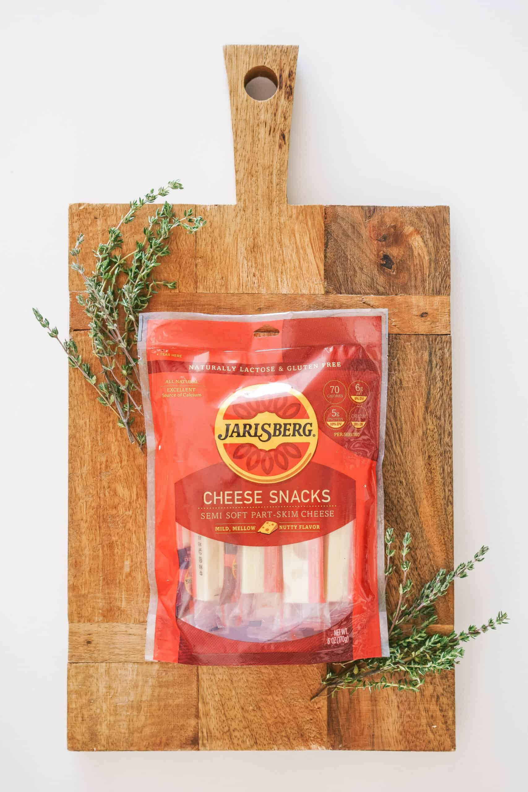 package of Jarlsberg Cheese snacks on a wooden cutting board