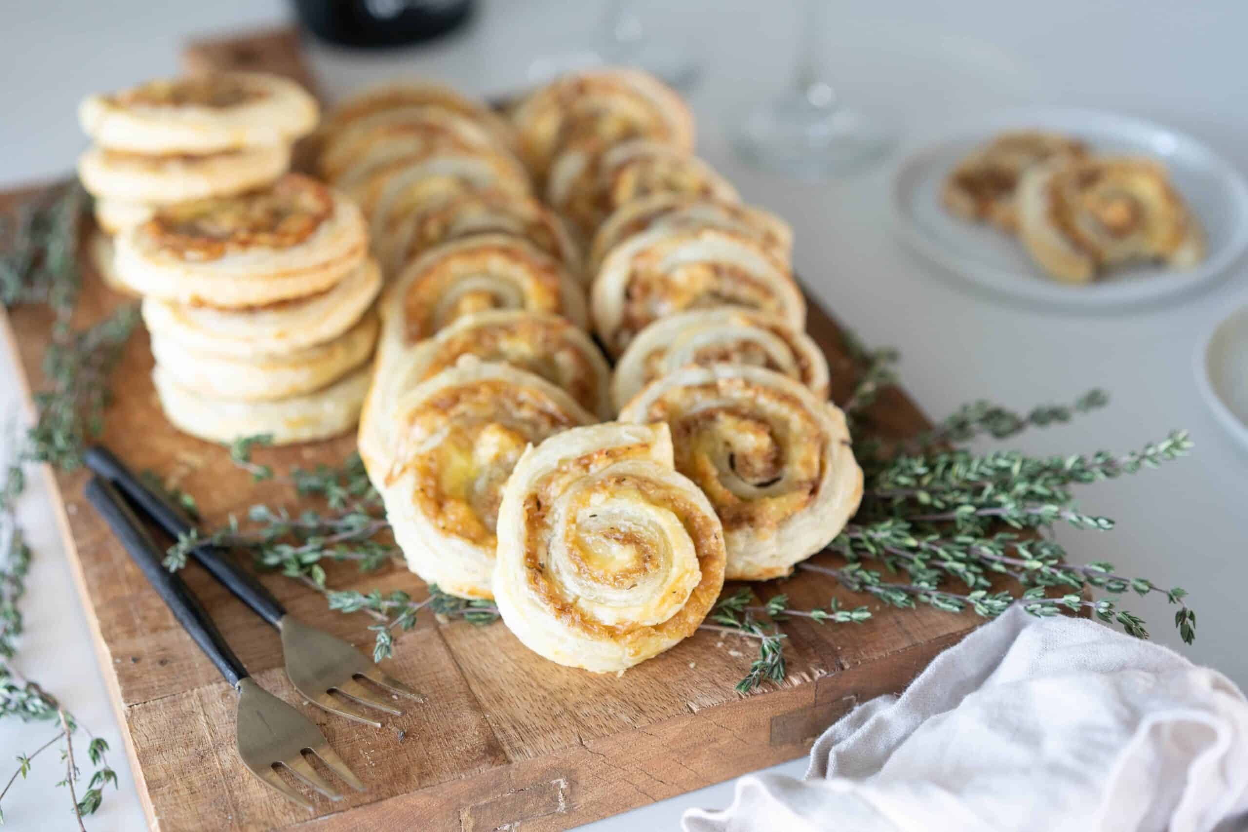 French Onion Soup Spirals on a wooden cutting board