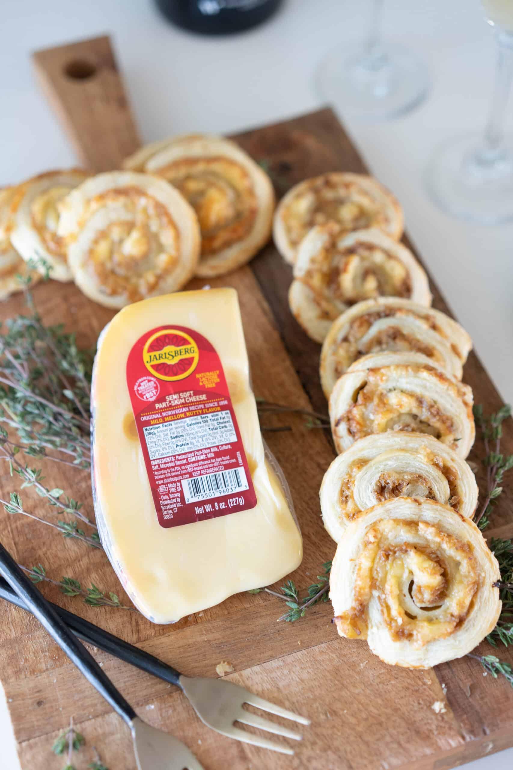 Jarlsberg Cheese block on a cutting board