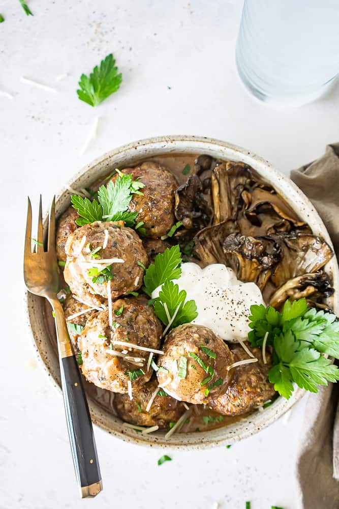 Using finely chopped mushrooms in this Maitake Mushroom Meatballs Recipe is the key to some of the most tender and flavor filled meatballs you'll ever eat!