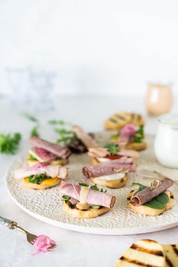 decorative trays of crostini sandwich bites