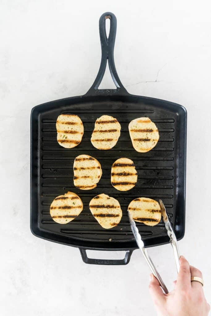 slices of French bread in a grill pan