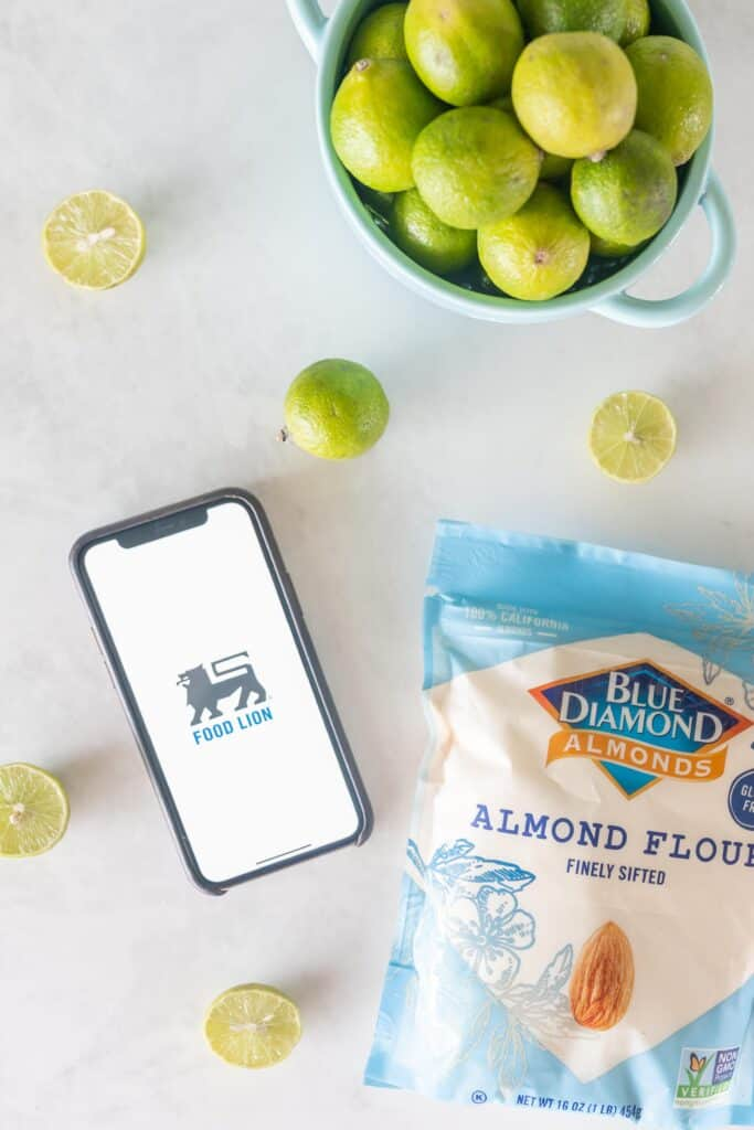 Blue diamond almond flour iPhone with food lion logo and key limes on a white background