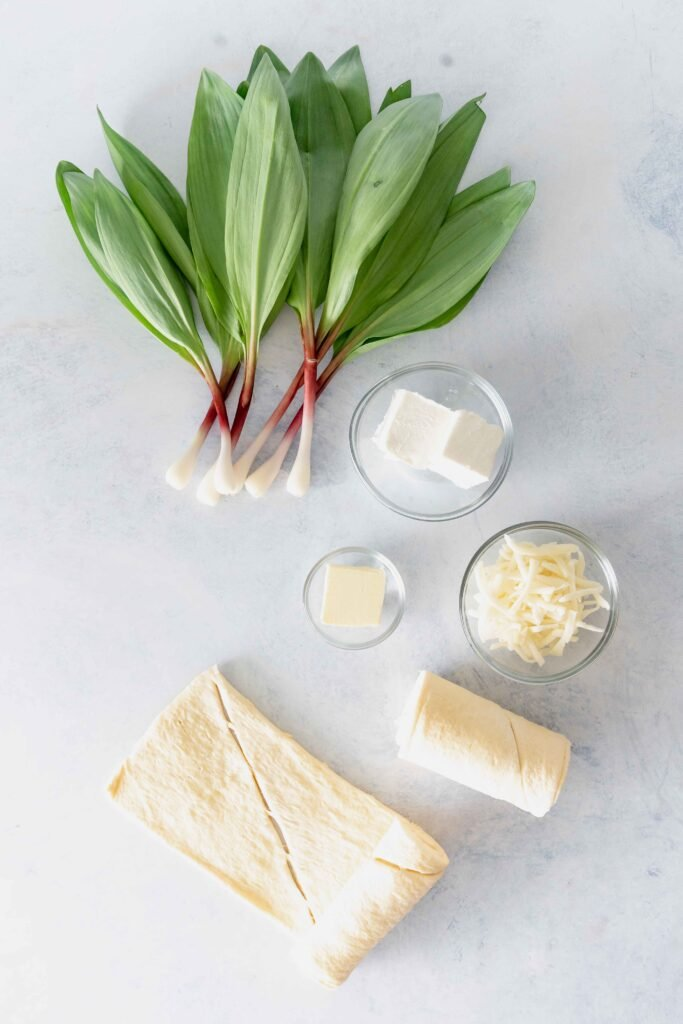 ramps, cream cheese, butter, Gruyere cheese and crescent dough on a blue background