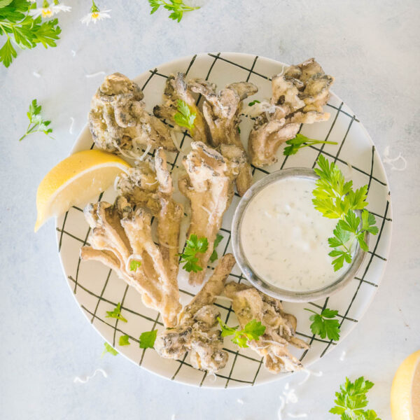 Breaded Maitake Mushrooms on a white plate with black plaid